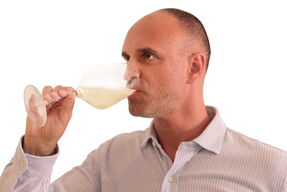 Wine maker tasting white wine